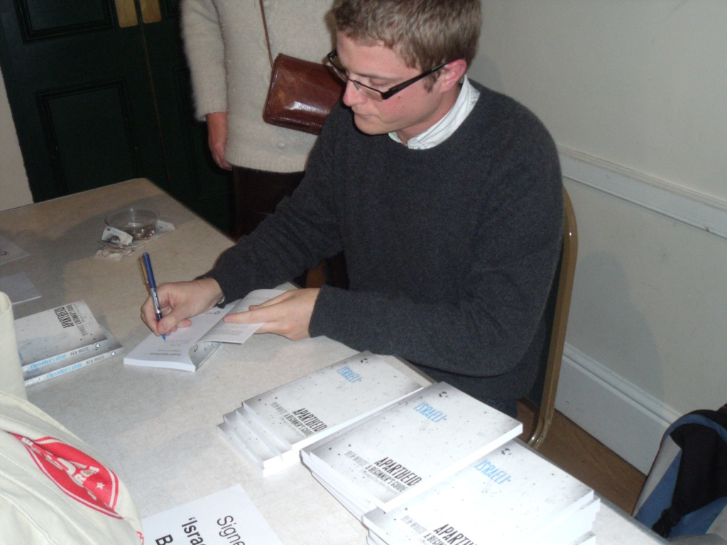 Ben White signing his book Israeli Apartheid, a Beginner's Guide