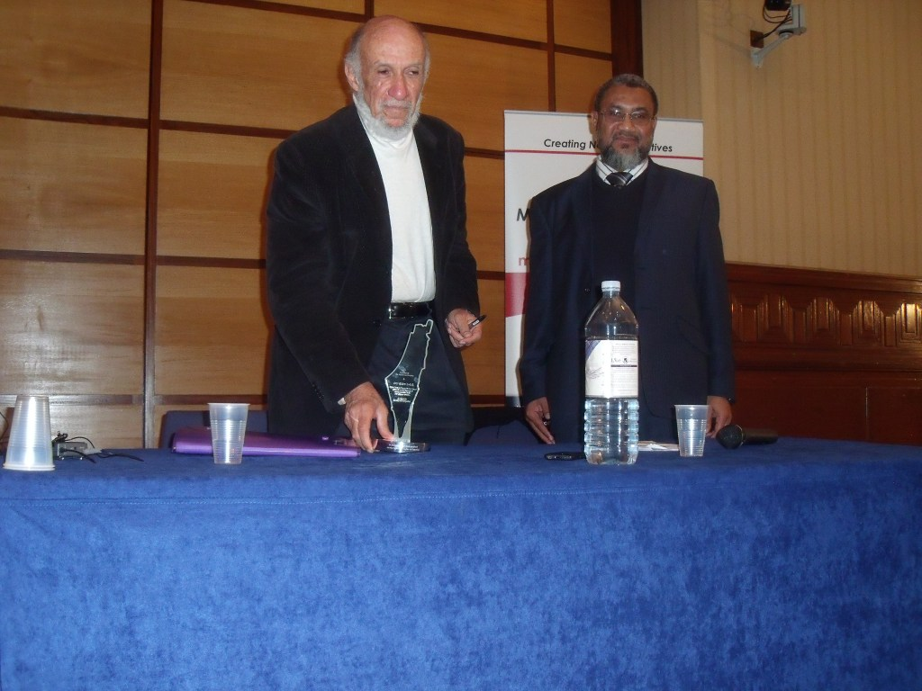 Daud Abdullah (right) presents Falk with his award depicting the end of the Jewish state.