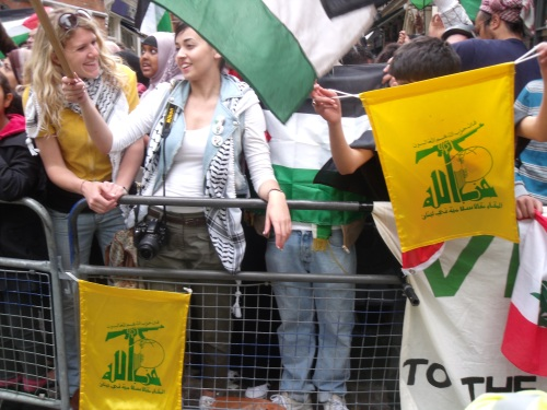 Hezbollah flag, with gun, on streets of London.