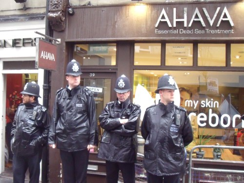 Police protecting Ahava from Palestine Solidarity Campaign activists.