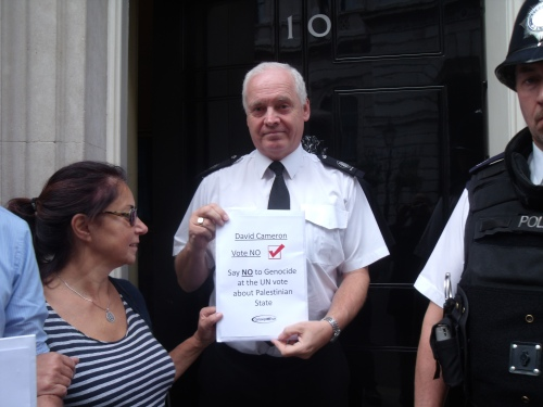 Sharon, of Campaign for Truth, hands in file to Number 10.