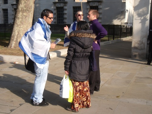 Explaining Israel's case to a passer-by.