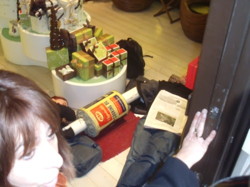 Jessica Nero and Christopher Osmond lying on floor inside Ahava on November 22nd 2010 shortly after Michael Mansfield's speech at Amnesty.