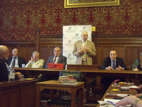 Kaufman calls for boycott of Israel. Andy Slaughter on his left and Jeremy Corbyn (scratching).