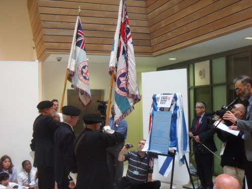 Jewish war veterans present a wreath.