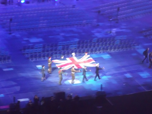 Marching with the Union Flag before it is raised.