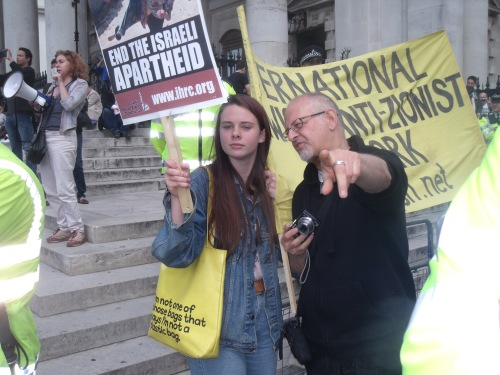An anti-Israel agitator pointing out yours truly to a new recruit.