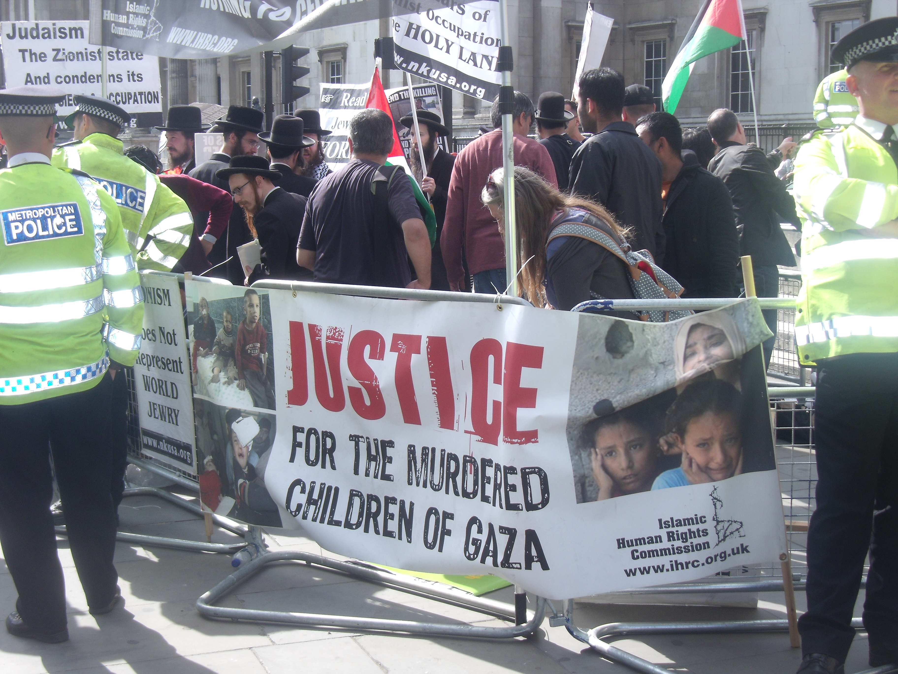 I agree with this placard. But the Palestinian children are being murdered by the Hamas government.