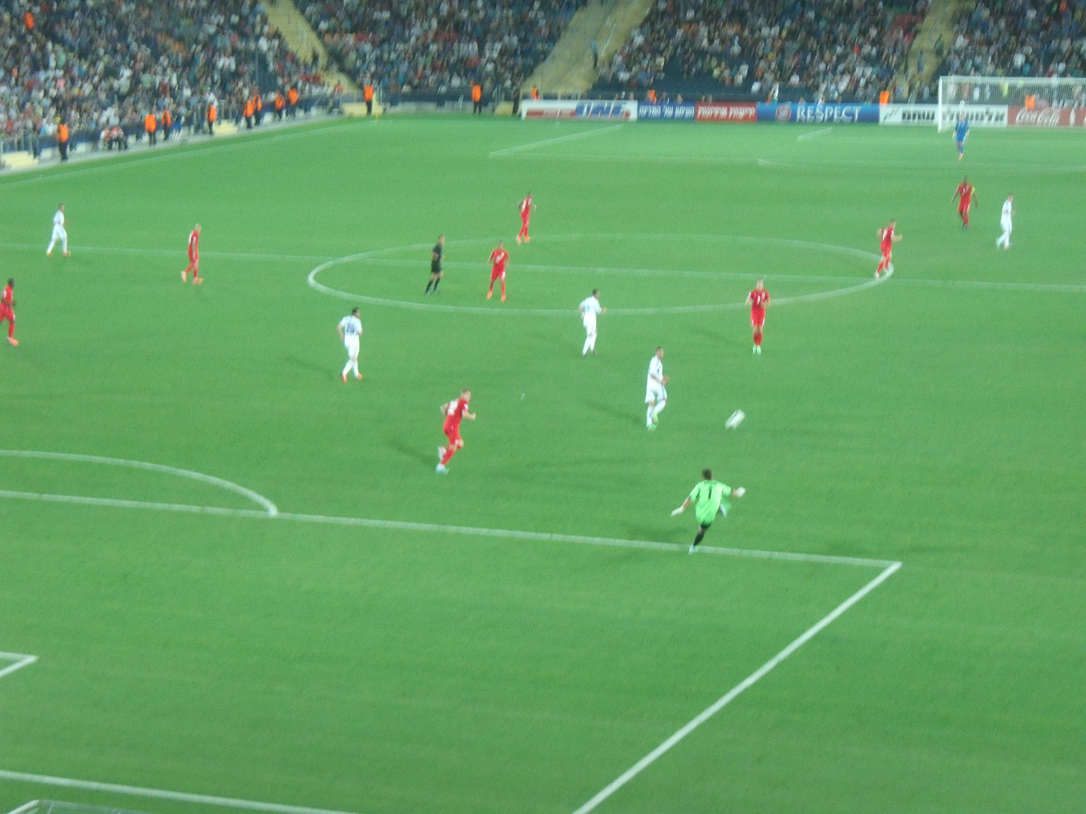 Israel's goalkeeper clears the ball as Israel go on the attack.