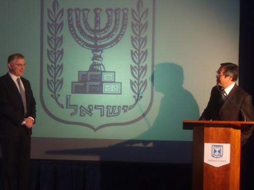 IMO secretary-general Koji Sekimuzu addresses Israeli Ambassador Daniel Taub last week.