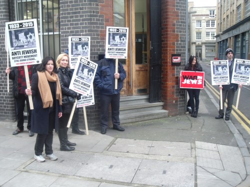 Protesting this morning outside War On Want's London HQ.
