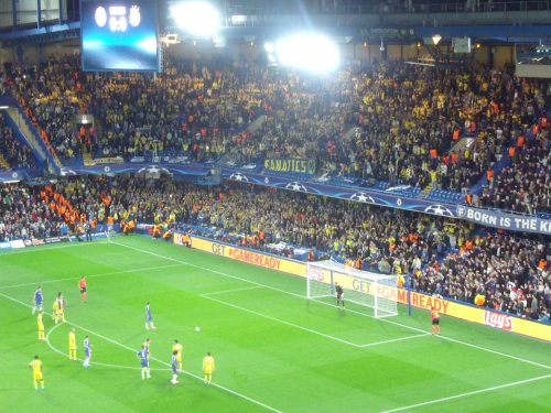 Eden Hazard about to blast his penalty over the bar in front of the 3000 Fanatics.